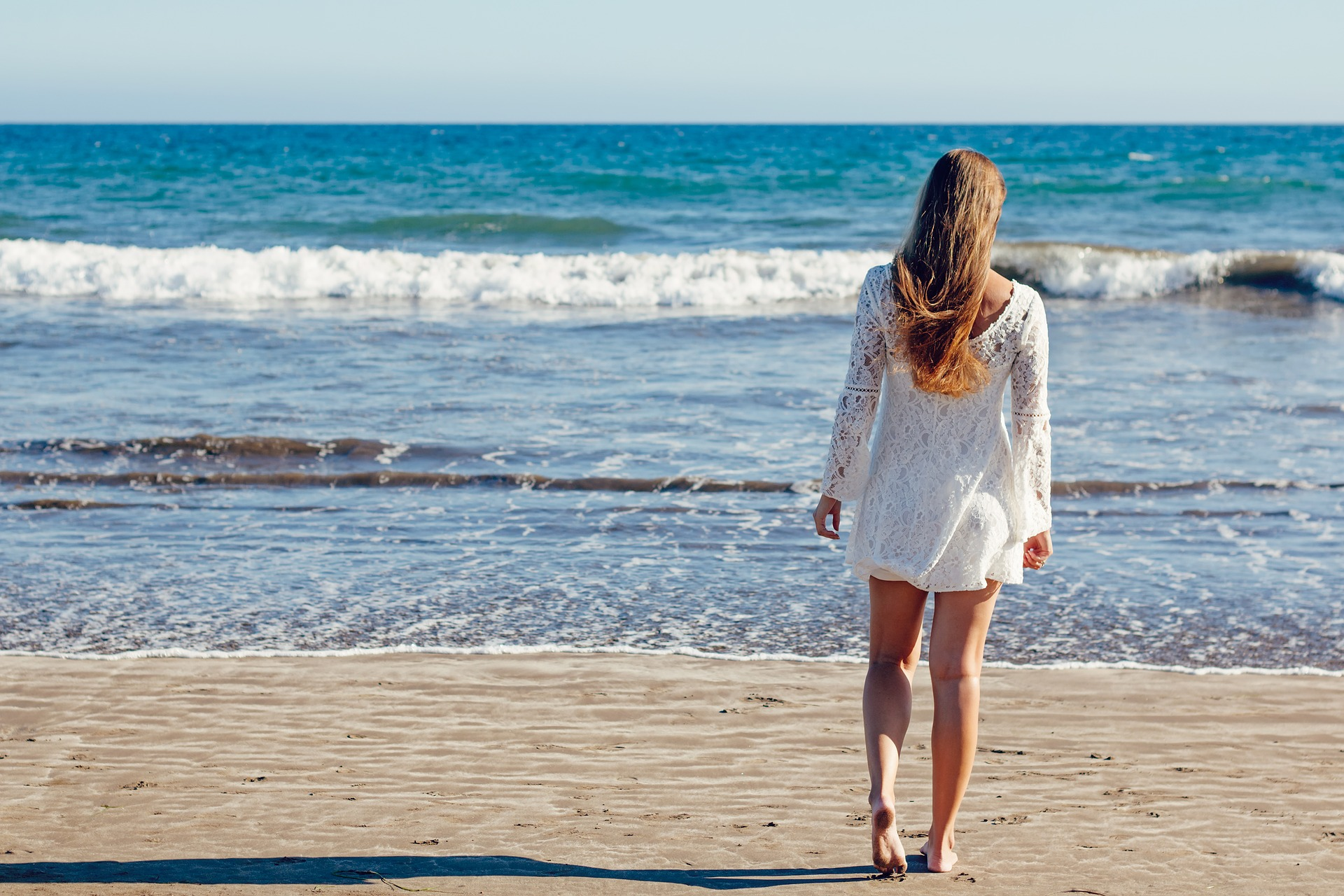 Lady walking on beach